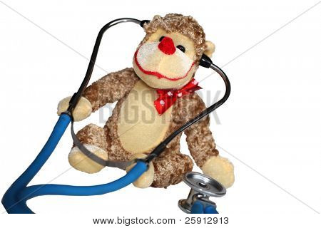 a generic stuffed toy monkey with a doctors stethoscope represents childrens doctors, pediatrics and fun check ups isolated on white