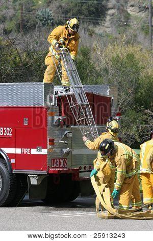 LAGUNA BEACH, CA - FEB 19: Firefighter recruits practice fire fighting drills at the local Fire Department training area on February 19, 2009 in Laguna Beach, California.