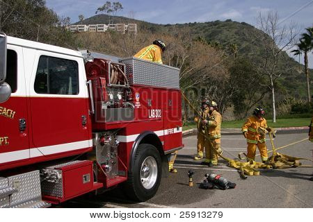 LAGUNA BEACH, CA - FEB 19: Firefighter recruits pack up after fire fighting drills at the local Fire Department training area on February 19, 2009 in Laguna Beach, California.
