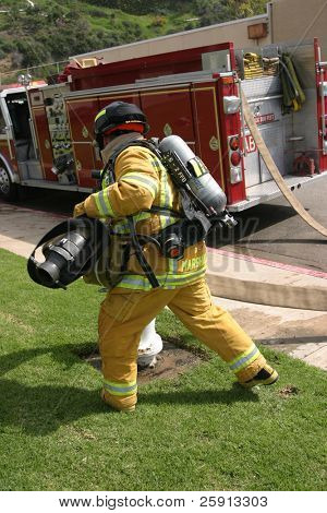 LAGUNA BEACH, CA - FEB 19: Firefighter recruit in action during fire fighting drills at the local Fire Department training area on February 19, 2009 in Laguna Beach, California.