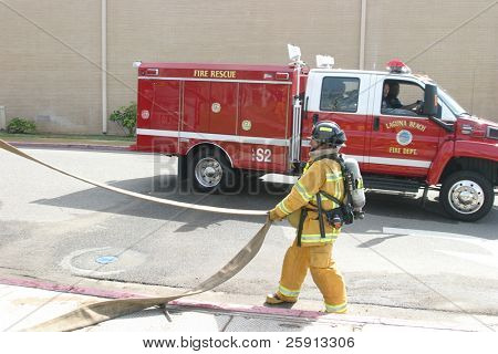 LAGUNA BEACH, CA - FEB 19: Firefighter recruit ready for action during fire fighting drills at the local Fire Department training area on February 19, 2009 in Laguna Beach, California.