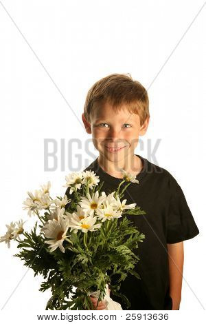 a young boy smiles as he holds a bunch of white daisies isolated on white with room for text