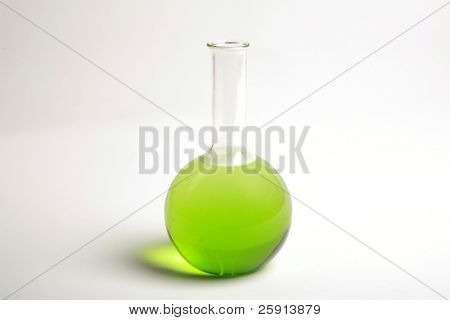 a glass chemistry beaker filled with green liquid
