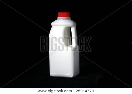 low key studio shot of a quart of milk with room for your text isolated on black