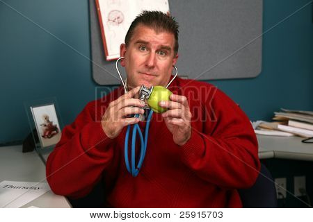a doctor checks his apple for a heart beat