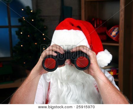 Santa looks through his binoculars