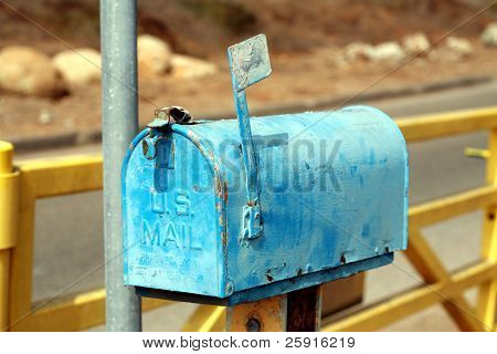 an old us postal mail box outdoors