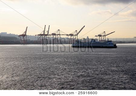 ferry boats go back and forth in enter elliot bay in seattle washington
