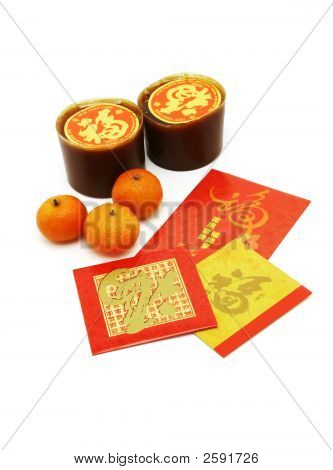 Chinese New Year Rice Cakes, Oranges And Red Packets