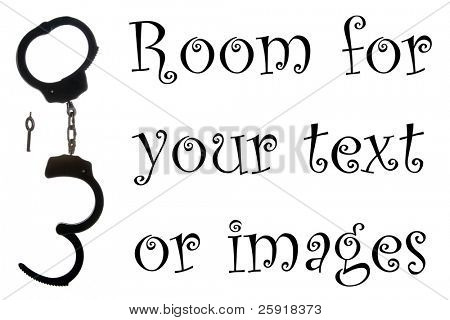 A fun pair of black steel handcuffs and its key, isolated on white with room for your text or images