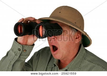 a man wearing a pith helmet looks through his binoculars isolated on white