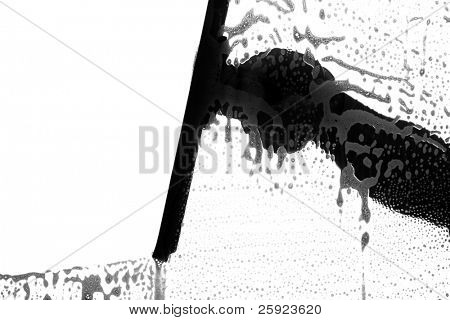 black and white silhouette of a window washer washing a window