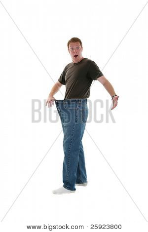 A handsome young man showing how much weight he lost, isolated on white