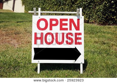 Real estate open house sign in a yard