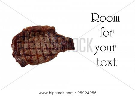 sizzling hot fresh grilled boneless rib eye steak isolated on white with barbecue grill marks in the meat