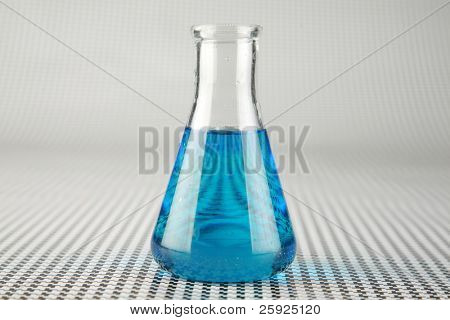 a chemist or medical research scientist adds chemicals to a erlenmeyer flask for a violent chemical reaction on a black and white background