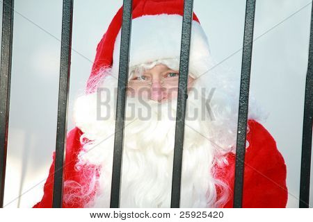 santa claus is behind bars in jail and needs your help to either be bailed out or escape before december 24th or there will no No Christmas for anyone this year