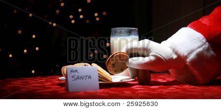 Santa Claus enjoys Cookies and Milk on Christmas Eve