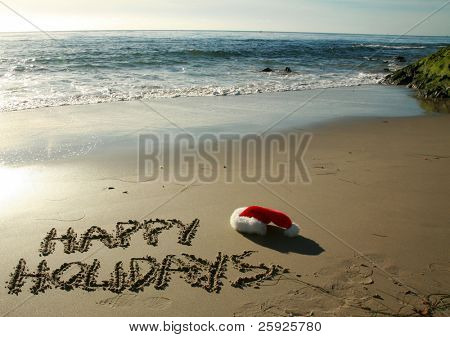"the words ""Happy Holidays"" written in wet sand with a ""Santa Hat"" on a secluded beach in ""southern california"" with the tide of the pacific ocean and blue sky in the background"