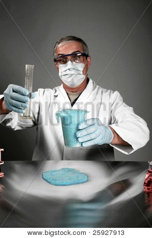 a medical research scientist or chemist works in his lab. shot in a