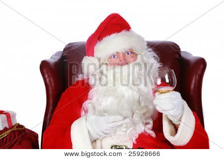 Santa Claus checks who has been naughty or nice in his big book. shot with a fisheye lens for a fun festive event. isolated on white with room for your text
