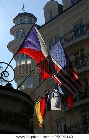 American, Czech, Israeli and German flags on a hotel in Karlovy Vary, Czech Republic