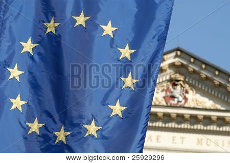 Flag of the European Union with the Czech national emblem in the background