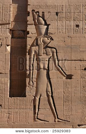 Falcon-headed god Horus, a bas-relief on Temple of Isis on the Philae Island near Aswan, Egypt
