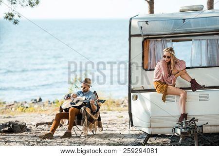 Beautiful Hippie Girl Sitting On