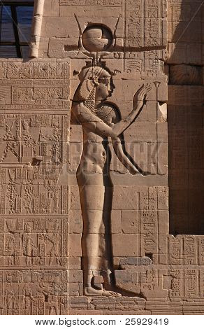 Egyptian goddess Isis, a bas-relief on Temple of Isis on the Philae Island near Aswan, Egypt