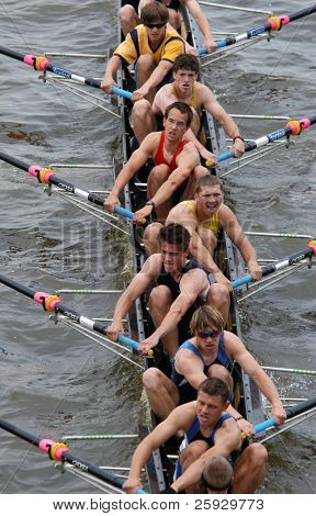 Junior rowing team rowing ahead during a boat-race on the River Vltava in Prague, Czech Republic.