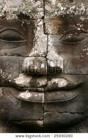 Huge stone face of Bodhisattva Lokesvara form Bayon Temple in the Angkor Area near Siem Reap, Cambodia.