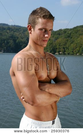 Muscular male model with army tags