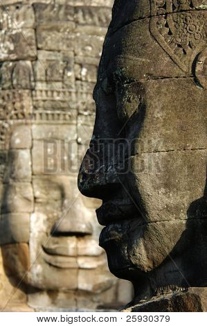 Huge stone faces of Bodhisattva Lokesvara form Bayon Temple in the Angkor Area near Siem Reap, Cambodia.