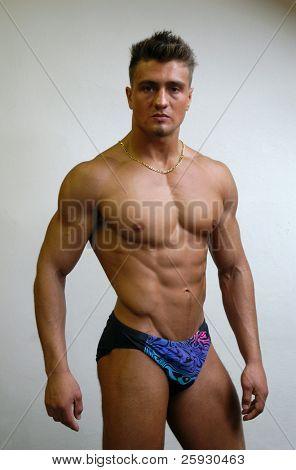 Muscular male model in swimwear