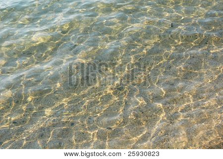 Sandy bottom through the clear water on Lake Baikal in Siberia, Russia