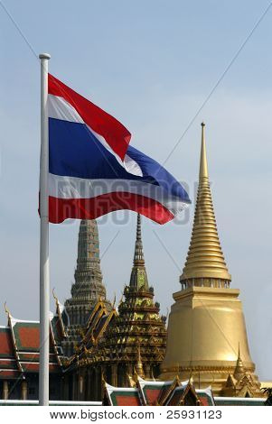 Thai national flag with the temple of the Emerald Buddha in the Royal Palace in Bangkok, Thailand