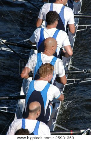 Rowing team rowing ahead during a boat-race on the River Vltava in Prague, Czech Republic