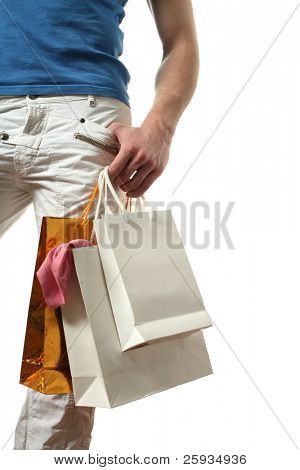 Young muscular sexy man with copy space shopping bags isolated on white