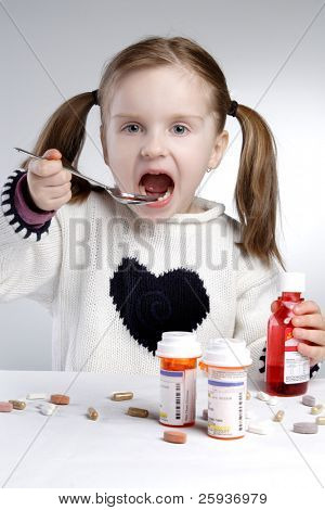 little girl taking medication