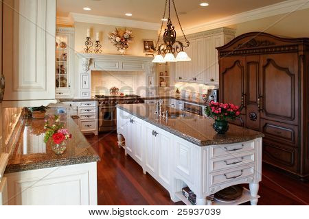 Luxury kitchen with granite counters.
