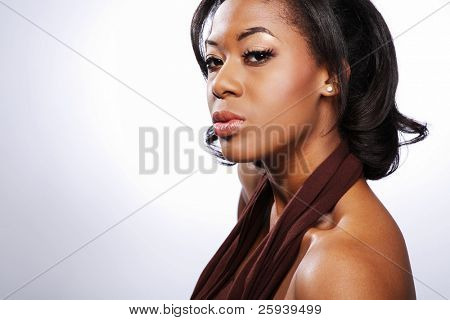 Young Africa-American fashion model wearing brown dress.