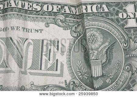 Macro shot of used one dollar bill.