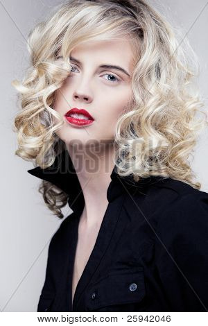 Young attractive female model with long curly hair.