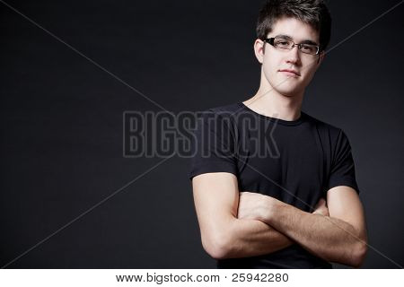 Young attractive happy man wearing black T-shirt.