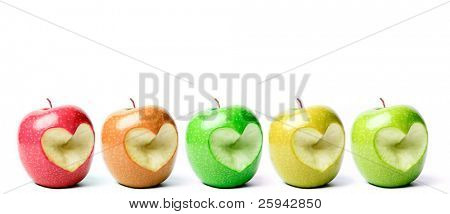 Colorful apples with cut off heart shape.