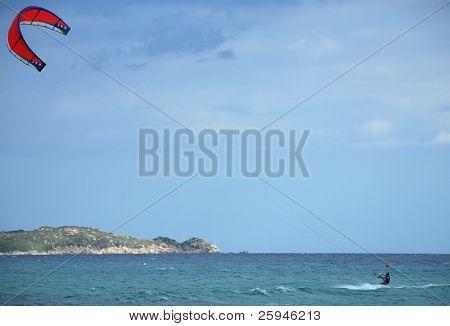 Kite surfer is enjoying windy weather on Sardinia
