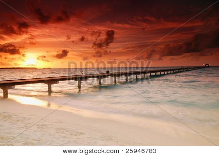 Gorgeous sunset over the sea and a jetty in the tropical paradise of Caribbean
