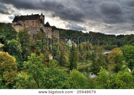 Castle Loket in the Northern Czech Republic is on the rock above the river Ohre. In this case we thanks to HDR see a cloudy weather before the storm