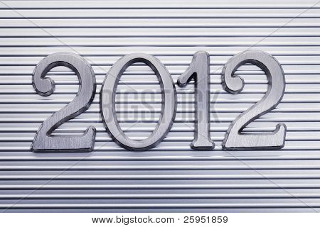 Number 2012 in small metallic letters.